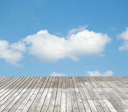 dirty: wooden floor against the sky with clouds