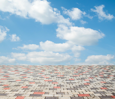 paving stones against the sky with clouds Reklamní fotografie