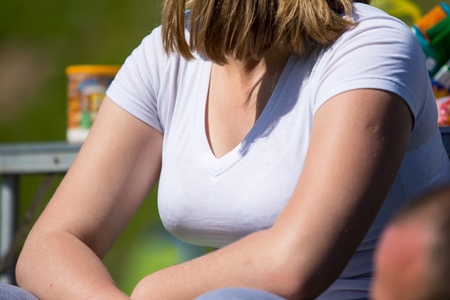 Womans breast in clothes