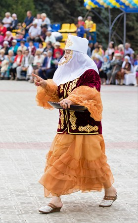 Constitución: Petropavlovsk, Kazakhstan - August 30, 2017: Kazakhstan marks Constitution Day. People in national costumes, holiday festivities. Editorial