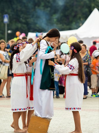 Petropavlovsk, Kazakhstan - August 30, 2017: Kazakhstan marks Constitution Day. People in national costumes, holiday festivities. Éditoriale