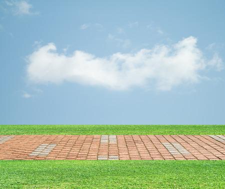 curve road: grass pavers sky clouds