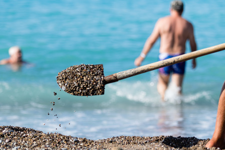 shovel gravel on the beach