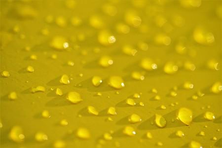 drops of rain on yellow, defocusing
