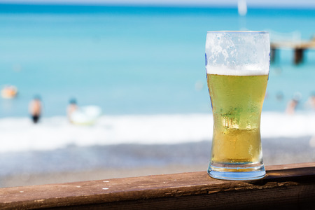 beer on the table, beach Stock Photo