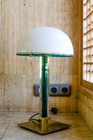 A table lamp on a marble floor