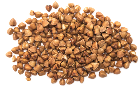 grains of buckwheat on white background