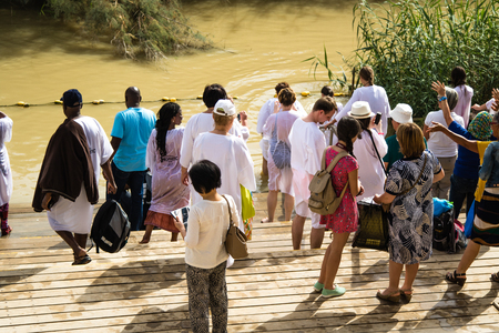JERICHO, ISRAEL - NOVEMBER 14. 2017: Pilgrims and tourists on Jordan River in Qasr el Yahud. Editorial