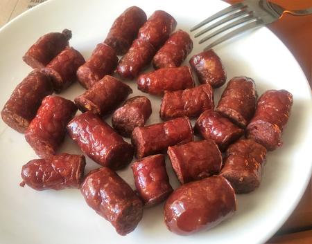 fried sausages on a plate Stock Photo