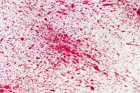 small splashes of red paint on white background