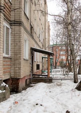 multi-storey house yard snow trees