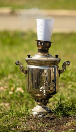 samovar on the ground grass