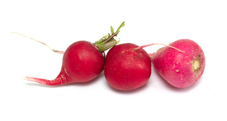 red radish is isolated on a white background Banco de Imagens
