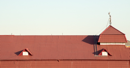 roof with red tile on the sky background