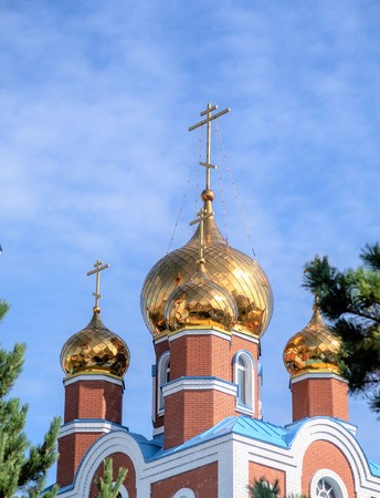 Orthodox temple of the dome crosses against the sky