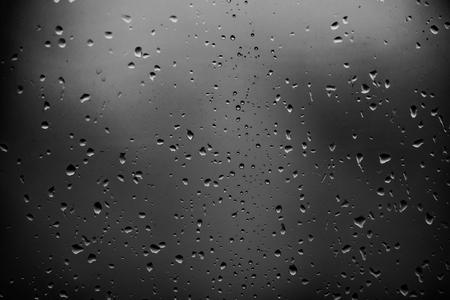 Raindrops on a dark glass background 스톡 콘텐츠