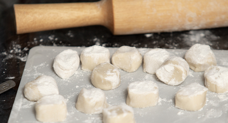 Homemade dumplings from dough and minced meat, preparation  ravioli, with minced meat close up. Stockfoto