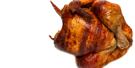 whole roast chicken on white background