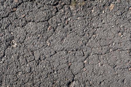 old asphalt background with a crack Imagens