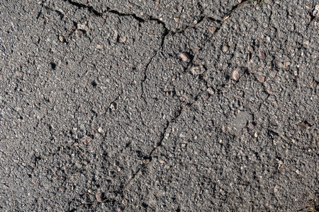 old asphalt background with a crack