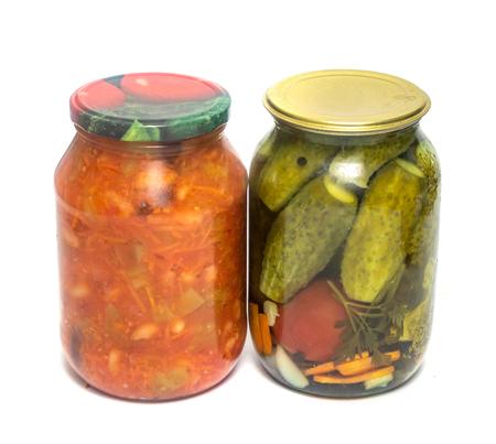 jar of pickled cucumber salad on white background