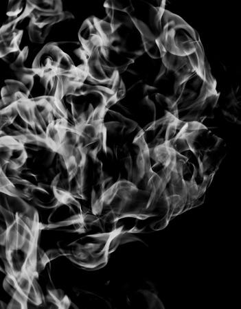 white smoke flame on a black background Stock Photo