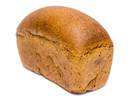 loaf of rye bread on a white background Фото со стока