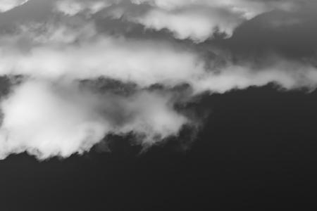 white clouds on a dark sky, monochrome