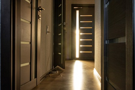 Doors and the suns rays on the floor.