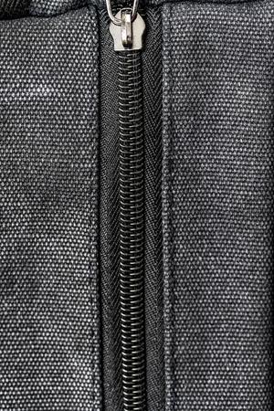 Texture of canvas fabric zipper lock, background.