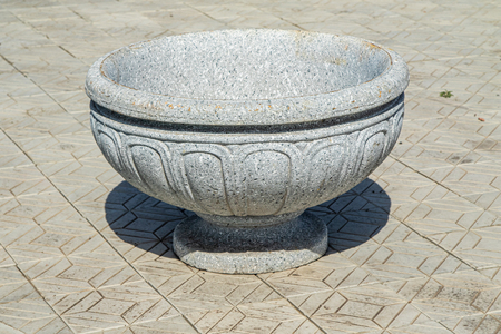 Vase stone on the street in the park pavement.