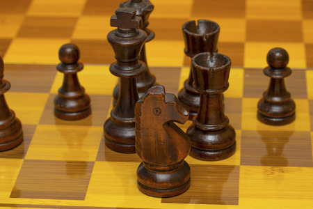 Chess pieces on a chessboard, wooden pieces. Banco de Imagens