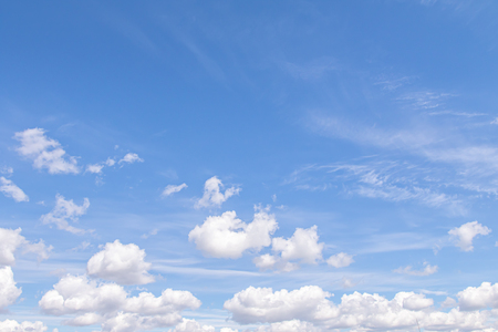 White clouds in the blue sky, day. Wallpaper.