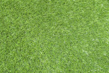 Textur des grünen Grases, Feld mit Kunstrasen für Fußball, Hintergrund.