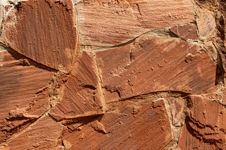 The texture of the stone. Brown stone wall background.