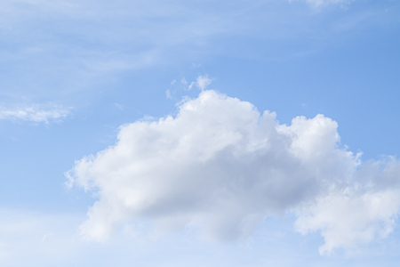 White clouds in the blue sky. Clouds are suspended in the atmosphere condensation of water vapor.