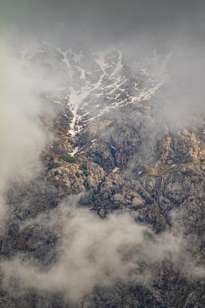 Mountains cliffs fog clouds nature summer.