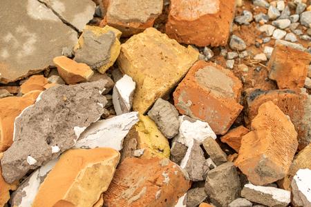 Background debris, brick concrete plaster crushed stone.