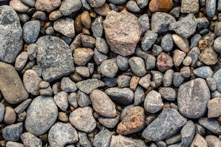 Round sea pebbles background.