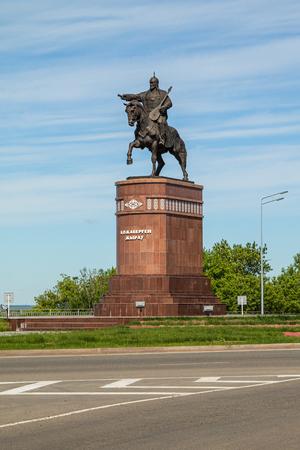 Petropavlovsk, Kazakhstan - June 3, 2019: Monument to the poet and commander Kozhabergen Zhyrau (1663–1763) at the entrance to the city of Petropavlovsk. Road street summer. Batyr on horseback, stone marble.
