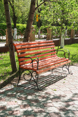 Wooden park bench spring landscape. Stock Photo