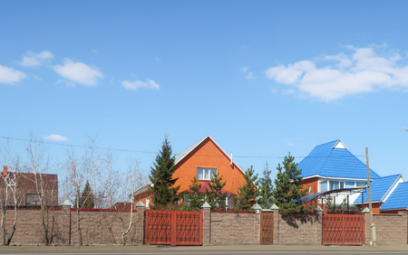 Petropavlovsk, Kazakhstan - May 2, 2019: House with a fence against the blue sky, spring landscape.