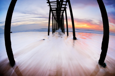 bridge into the sea on the beach,shooting with Lens fish eye photo