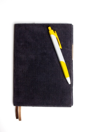 notebook and pen , isolated on white background photo