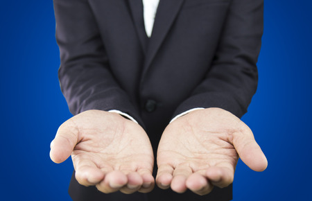 Business hands as if holding something . Blue background photo