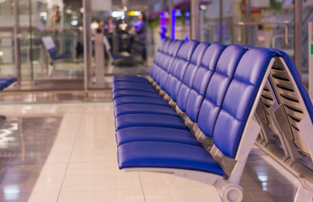 background of the empty blue bench in the aiport, transportation concept