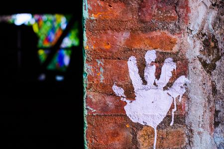 Hand prints on the brick wall Stock Photo