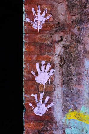 kiddy: Hand prints on the brick wall Stock Photo