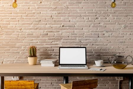 Work space with laptop and teapot on table loft style. 3D Rendering.