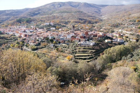 terracing: General view of the people, cemetery, church, typical houses of brick and adobe, terracing, mountains to the fund  Vera, Extremadura